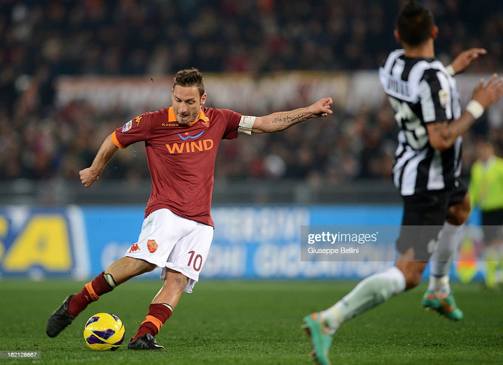 <a gi-track='captionPersonalityLinkClicked' href=/galleries/search?phrase=Francesco+Totti&family=editorial&specificpeople=208985 ng-click='$event.stopPropagation()'>Francesco Totti</a> of Roma scores the opening goal during the Serie A match between AS Roma and Juventus FC at Stadio Olimpico on February 16, 2013 in Rome, Italy.