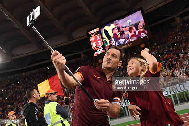 Francesco Totti of Roma take a selfie after the Serie A match between AS Roma and US Citta di Palermo at Stadio Olimpico on May 31 2015 in Rome Italy