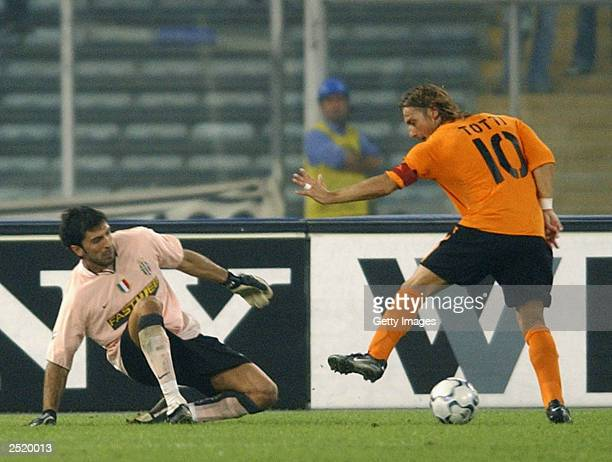 Francesco Totti of Roma takes on Gianluigi Buffon of Juve during the Serie A match between Juventus and Roma at the Stadio Delle Alpi September 21...