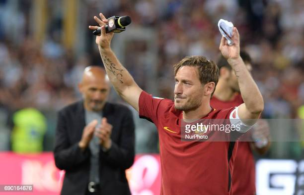Francesco Totti reads a letter to Roma fans at the end of the Italian Serie A football match between AS Roma and FC Genoa at the Olympic Stadium in...