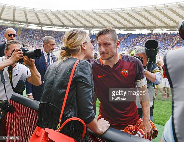 Francesco Totti smack Ilary Blasy during the Italian Serie A football match between AS Roma and AC Chievo Verona at the Olympic Stadium in Rome on...