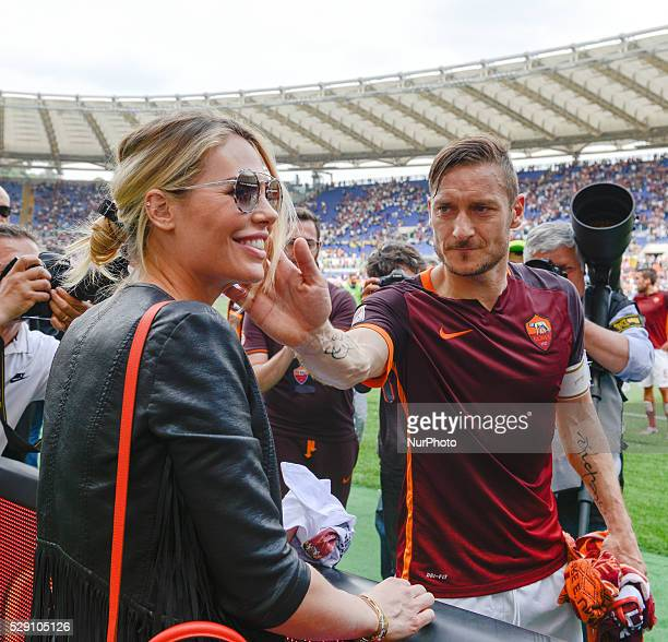 Francesco Totti to caress Ilary Blasy during the Italian Serie A football match between AS Roma and AC Chievo Verona at the Olympic Stadium in Rome...