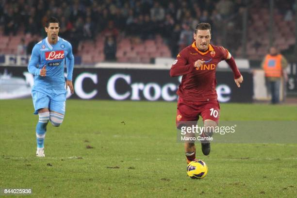 Francesco Totti with Britos during a soccer match at the San Paolo stadium between Roma and Napoli