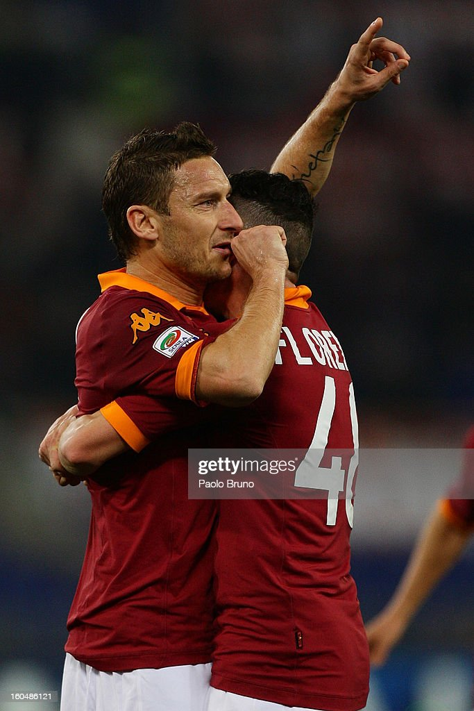 <a gi-track='captionPersonalityLinkClicked' href=/galleries/search?phrase=Francesco+Totti&family=editorial&specificpeople=208985 ng-click='$event.stopPropagation()'>Francesco Totti</a> (L) with his teammate Alessandro Florenzi of AS Roma celebrates after scoring the first team's goal during the Serie A match between AS Roma and Cagliari Calcio at Stadio Olimpico on February 1, 2013 in Rome, Italy.