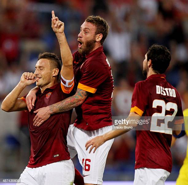 Francesco Totti with his teammate Daniele De Rossi and Mattia Destro of AS Roma celebrates after scoring the third team's goal from penalty spot...