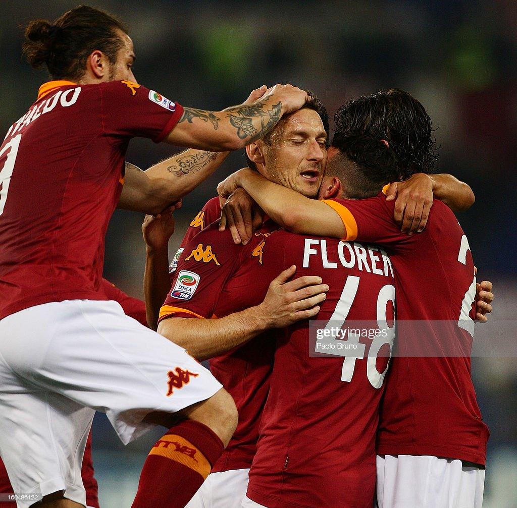 <a gi-track='captionPersonalityLinkClicked' href=/galleries/search?phrase=Francesco+Totti&family=editorial&specificpeople=208985 ng-click='$event.stopPropagation()'>Francesco Totti</a> (C) with his teammates of AS Roma celebrates after scoring the first team's goal during the Serie A match between AS Roma and Cagliari Calcio at Stadio Olimpico on February 1, 2013 in Rome, Italy.