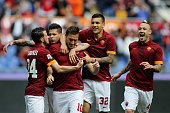 Francesco Totti with his teammates of AS Roma celebrates after scoring the opening goal from penalty spot during the Serie A match between AS Roma...