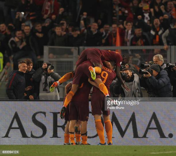 Francesco Totti with his teammates of AS Roma celebrates after scoring the team's second goal from penalty spot during the Serie A match between AS...