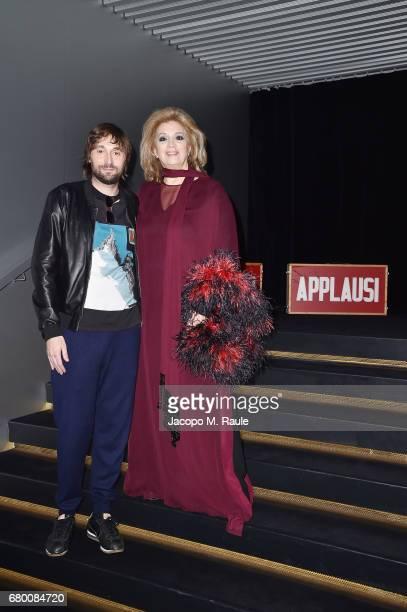 Francesco Vezzoli and Iva Zanicchi attend a 'Private view of 'TV 70 Francesco Vezzoli Guarda La Rai' at Fondazione Prada on May 7 2017 in Milan Italy