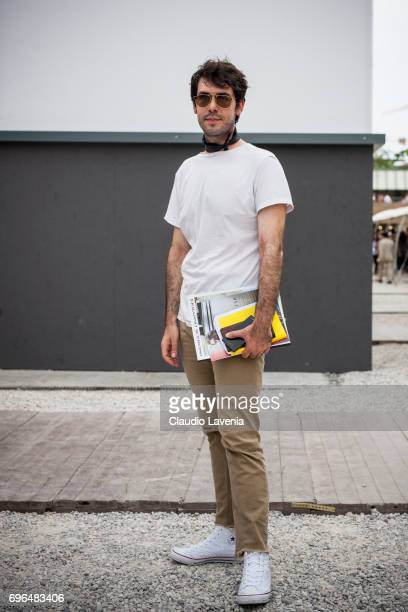 Francesco Zenere wearing white tshirt and cream pants is seen during Pitti Immagine Uomo 92 at Fortezza Da Basso on June 15 2017 in Florence Italy