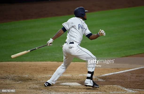 Franchy Cordero of the San Diego Padres hits a solo home run during the seventh inning of a baseball game against the Cincinnati Reds at PETCO Park...