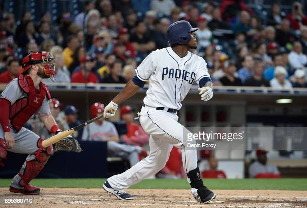 Franchy Cordero of the San Diego Padres hits a tworun home run during the second inning of a baseball game against the Cincinnati Reds at PETCO Park...