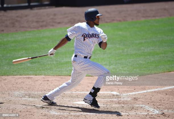 Franchy Cordero of the San Diego Padres hits an RBI double during the seventh inning of a baseball game against the Cincinnati Reds at PETCO Park on...