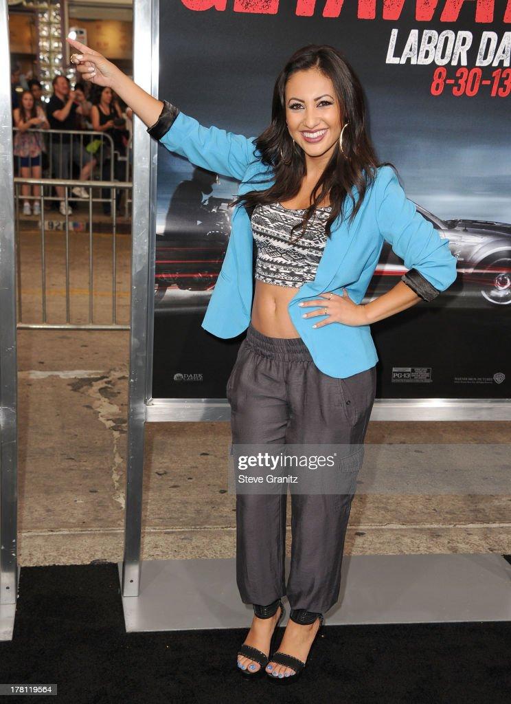 Francia Raisa arrives at the 'Getaway' Los Angeles Premiere at Regency Village Theatre on August 26 2013 in Westwood California