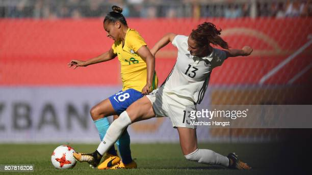 Franciella Alberto Manoel of Brazilis challenged by Sara Daebritz of Germany during the Women's International Friendly match between Germany and...