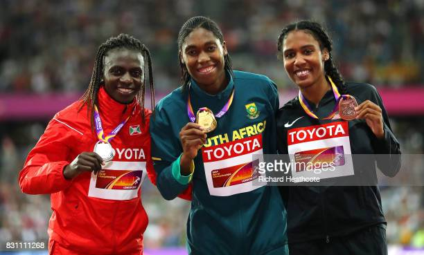 Francine Niyonsaba of Burundi silver Caster Semenya of South Africa gold and Ajee Wilson of the United States bronze pose with their medals for the...
