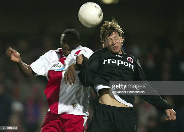 Francis Adissa Kioyo of Cottbus challenges for the ball with Marco Russ of Frankfurt during the Bundesliga match between Energie Cottbus and...