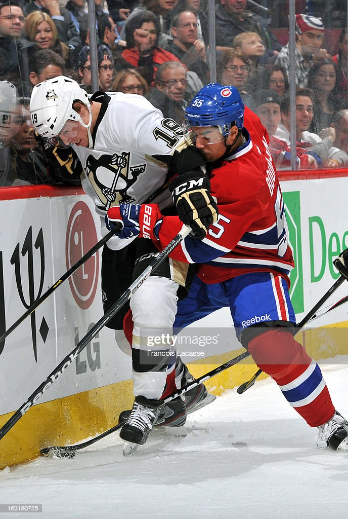 Francis Bouillon of the Montreal Canadiens and Beau Bennett of the Pittsburgh Penguins battle for the puck during the NHL game on March 2 2013 at the...