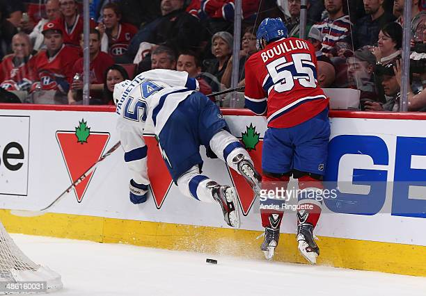 Francis Bouillon of the Montreal Canadiens and Cedric Paquette of the Tampa Bay Lightning collide into the end boards during Game Four of the First...