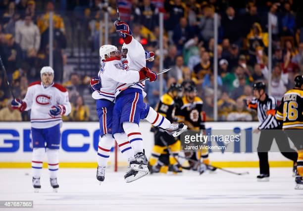 Francis Bouillon of the Montreal Canadiens celebrates his goal in the third period with teammate PK Subban against the Boston Bruins in Game One of...