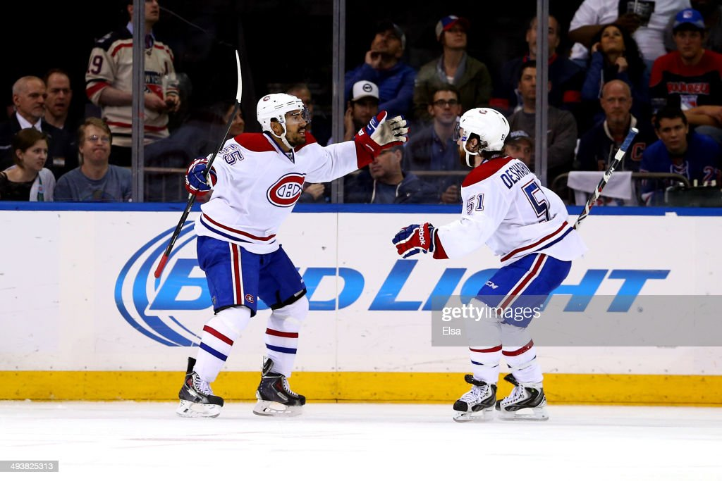 <a gi-track='captionPersonalityLinkClicked' href=/galleries/search?phrase=Francis+Bouillon&family=editorial&specificpeople=215165 ng-click='$event.stopPropagation()'>Francis Bouillon</a> #55 of the Montreal Canadiens celebrates with his teammate <a gi-track='captionPersonalityLinkClicked' href=/galleries/search?phrase=David+Desharnais&family=editorial&specificpeople=4084305 ng-click='$event.stopPropagation()'>David Desharnais</a> #51 after scoring a goal in the second period against Henrik Lundqvist #30 of the New York Rangers during Game Four of the Eastern Conference Final in the 2014 NHL Stanley Cup Playoffs at Madison Square Garden on May 25, 2014 in New York City.