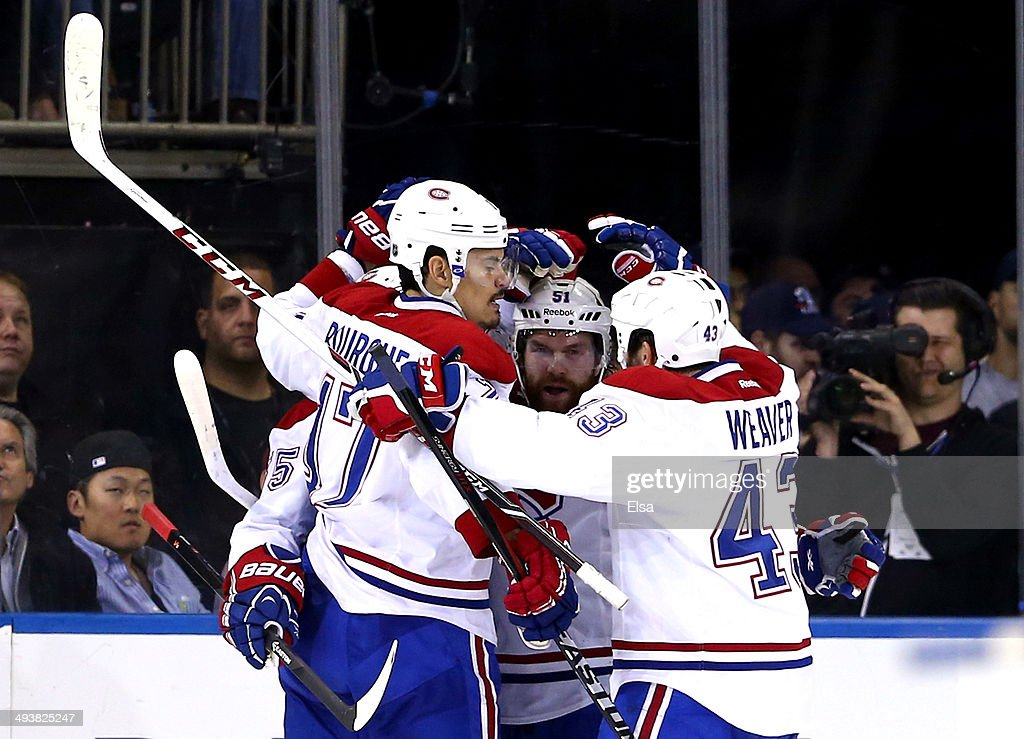 <a gi-track='captionPersonalityLinkClicked' href=/galleries/search?phrase=Francis+Bouillon&family=editorial&specificpeople=215165 ng-click='$event.stopPropagation()'>Francis Bouillon</a> #55 of the Montreal Canadiens celebrates with his teammates <a gi-track='captionPersonalityLinkClicked' href=/galleries/search?phrase=Rene+Bourque&family=editorial&specificpeople=685715 ng-click='$event.stopPropagation()'>Rene Bourque</a> #17, <a gi-track='captionPersonalityLinkClicked' href=/galleries/search?phrase=David+Desharnais&family=editorial&specificpeople=4084305 ng-click='$event.stopPropagation()'>David Desharnais</a> #51 and Mike Weaver #43 after scoring a goal in the second period against Henrik Lundqvist #30 of the New York Rangers during Game Four of the Eastern Conference Final in the 2014 NHL Stanley Cup Playoffs at Madison Square Garden on May 25, 2014 in New York City.