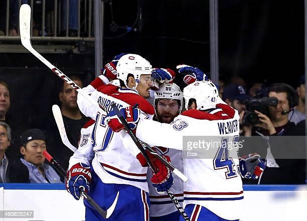 Francis Bouillon of the Montreal Canadiens celebrates with his teammates Rene Bourque David Desharnais and Mike Weaver after scoring a goal in the...