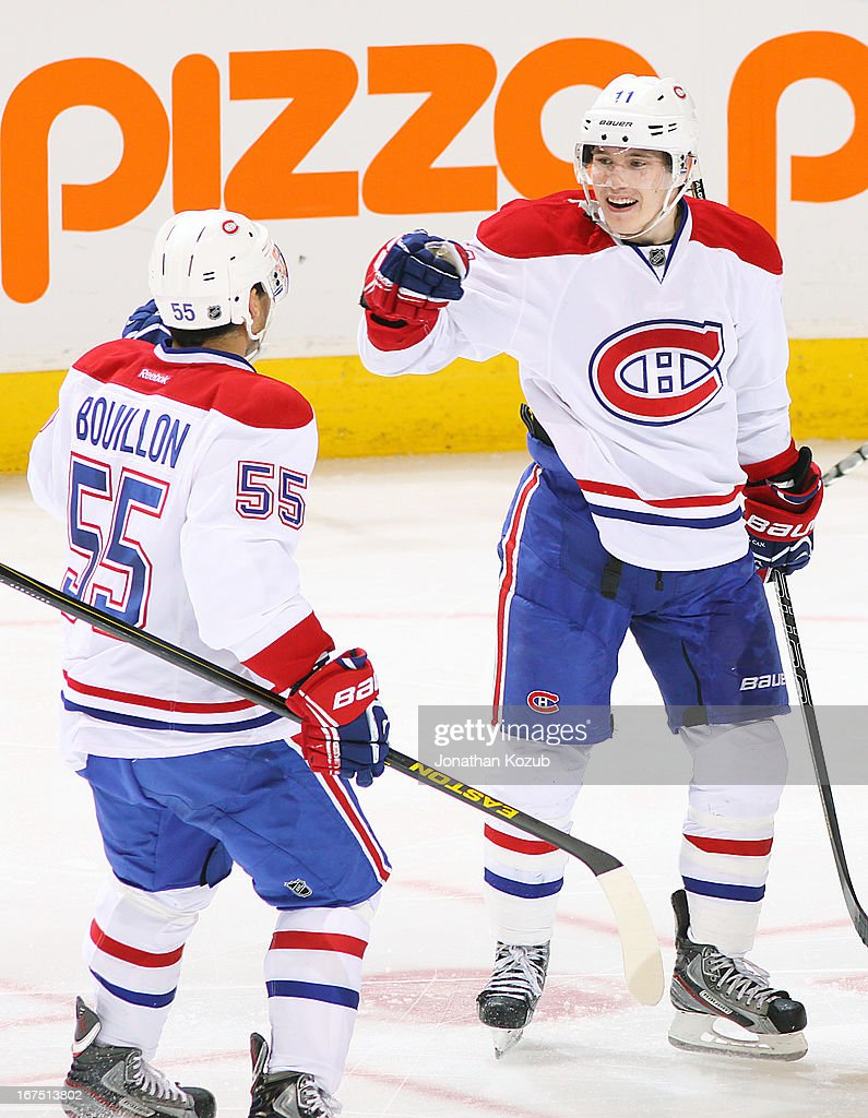 <a gi-track='captionPersonalityLinkClicked' href=/galleries/search?phrase=Francis+Bouillon&family=editorial&specificpeople=215165 ng-click='$event.stopPropagation()'>Francis Bouillon</a> #55 of the Montreal Canadiens celebrates with teammate <a gi-track='captionPersonalityLinkClicked' href=/galleries/search?phrase=Brendan+Gallagher&family=editorial&specificpeople=3704208 ng-click='$event.stopPropagation()'>Brendan Gallagher</a> #11 following a third period goal against the Winnipeg Jets at the MTS Centre on April 25, 2013 in Winnipeg, Manitoba, Canada.