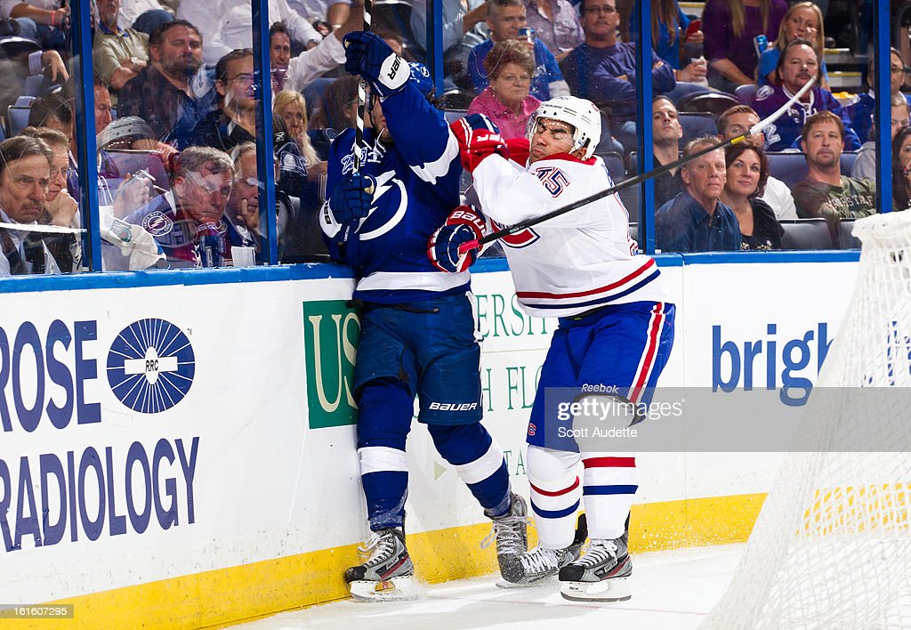 <a gi-track='captionPersonalityLinkClicked' href=/galleries/search?phrase=Francis+Bouillon&family=editorial&specificpeople=215165 ng-click='$event.stopPropagation()'>Francis Bouillon</a> #55 of the Montreal Canadiens checks Nate Thompson #44 of the Tampa Bay Lightning during the third period of the game at the Tampa Bay Times Forum on February 12, 2013 in Tampa, Florida.