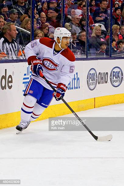 Francis Bouillon of the Montreal Canadiens controls the puck during the game against the Columbus Blue Jackets on November 15 2013 at Nationwide...