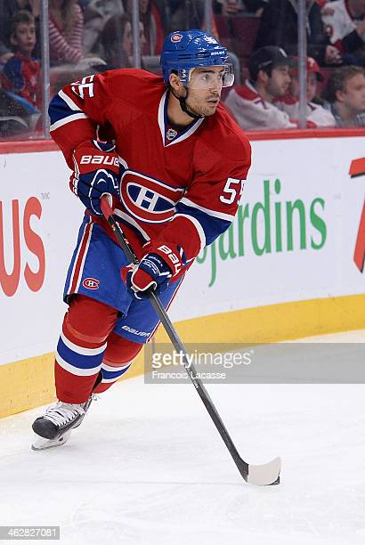 Francis Bouillon of the Montreal Canadiens controls the puck during the game against the Ottawa Senators during the NHL game on January 4 2014 at the...