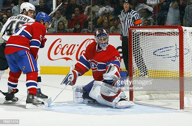 Francis Bouillon of the Montreal Canadiens defends Tyler Kennedy of the Pittsburgh Penguins as goaltender Carey Price of the Montreal Canadiens...