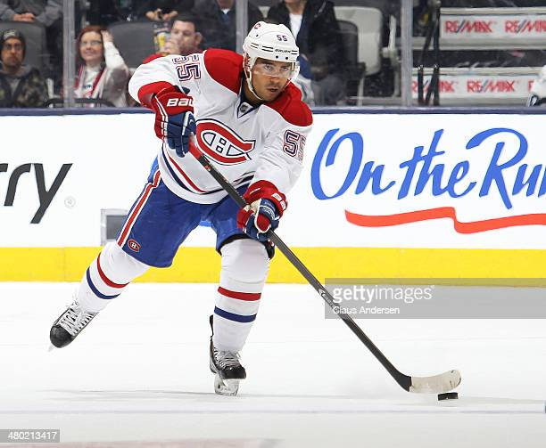 Francis Bouillon of the Montreal Canadiens makes a pass against the Toronto Maple Leafs during an NHL game at the Air Canada Centre on March 22 2014...
