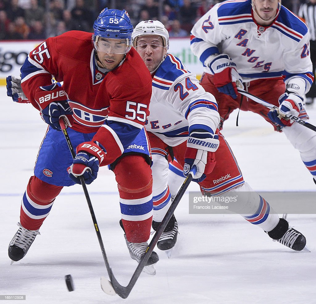 Francis Bouillon #55 of the Montreal Canadiens protects the puck from Ryan Callahan #24 of the New York Rangers during the NHL game on March 30, 2013 at the Bell Centre in Montreal, Quebec, Canada.