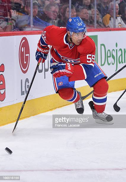 Francis Bouillon of the Montreal Canadiens skates with the puck against the Boston Bruins during the NHL game on April 6 2013 at the Bell Centre in...