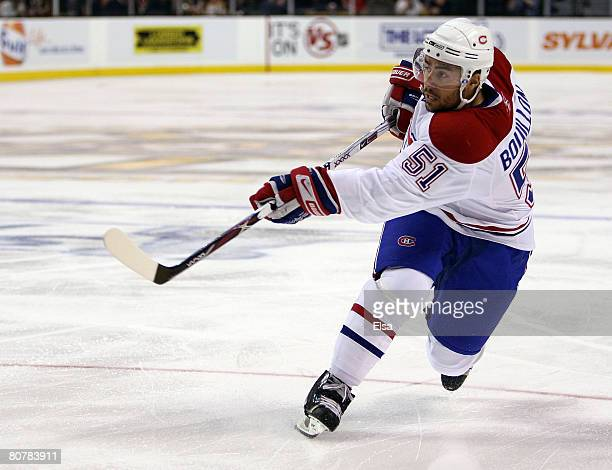 Francis Bouillon of the Montreal Canadiens takes a shot in the first period to score against the Boston Bruins during game six of the 2008 NHL...