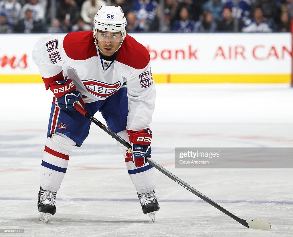 Francis Bouillon of the Montreal Canadiens waits for a faceoff against the Toronto Maple Leafs during an NHL game at the Air Canada Centre on March...