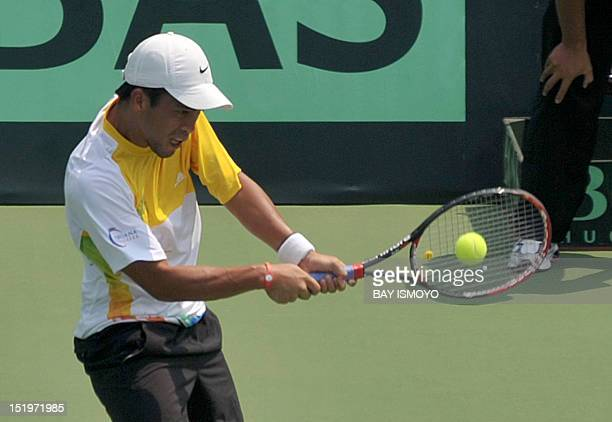 Francis Casey Alcantara of the Philippines returns a shot during the final round of the men's tennis singles Davis Cup AsiaOceania Zone group II...