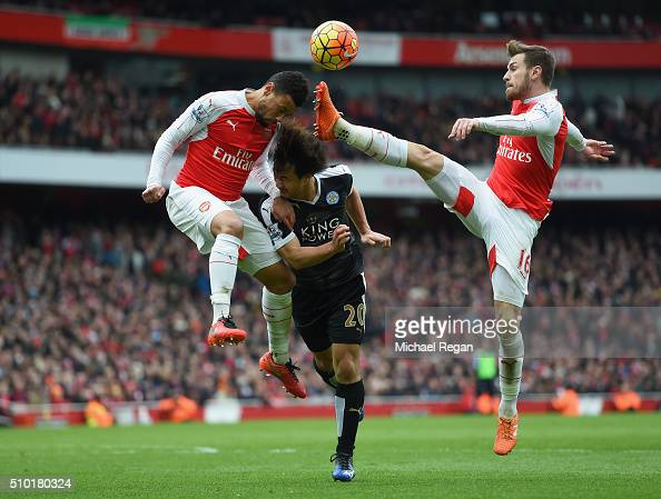 Francis Coquelin and Aaron Ramsey of Arsenal in action with Shinji Okazaki of Leicester City during the Barclays Premier League match between Arsenal...