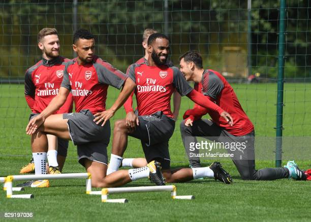 Francis Coquelin and Alex Lacazette of Arsenal during a training session at London Colney on August 10 2017 in St Albans England