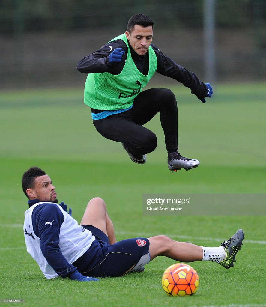 Francis Coquelin and Alexis Sanchez of Arsenal during a training session at London Colney on February 1 2016 in St Albans England