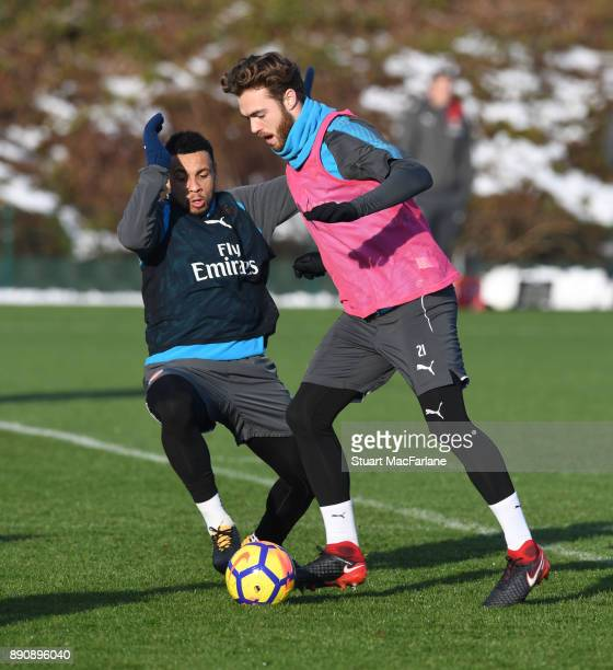 Francis Coquelin and Calum Chambers of Arsenal during a training session at London Colney on December 12 2017 in St Albans England