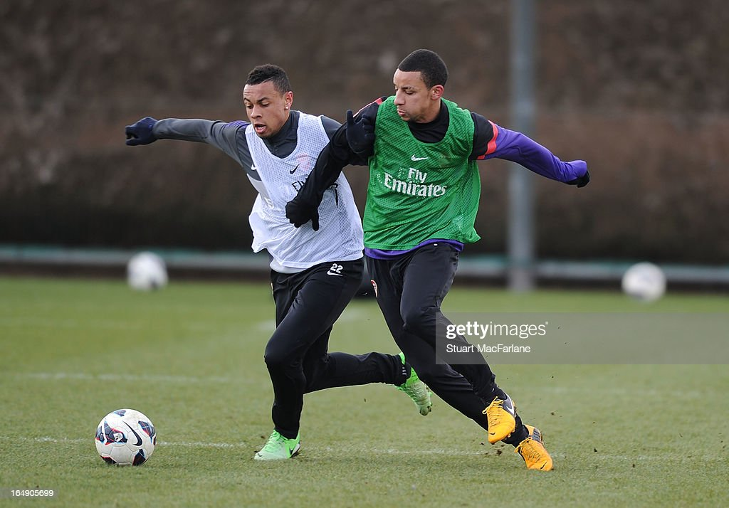 Francis Coquelin and Craig Eastmond of Arsenal during a training session at London Colney on March 29, 2013 in St Albans, England.