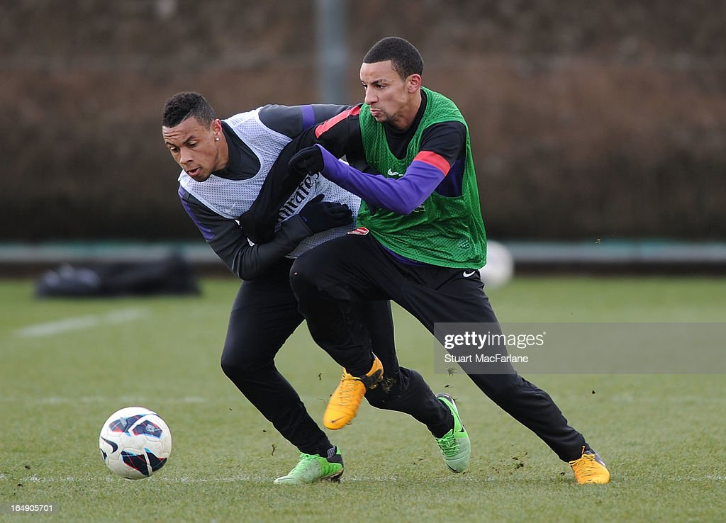 <a gi-track='captionPersonalityLinkClicked' href=/galleries/search?phrase=Francis+Coquelin&family=editorial&specificpeople=8957797 ng-click='$event.stopPropagation()'>Francis Coquelin</a> and Craig Eastmond of Arsenal during a training session at London Colney on March 29, 2013 in St Albans, England.