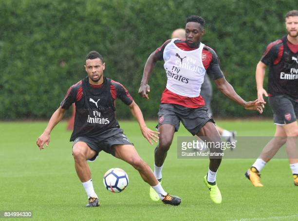 Francis Coquelin and Danny Welbeck of Arsenal during a training session at London Colney on August 18 2017 in St Albans England