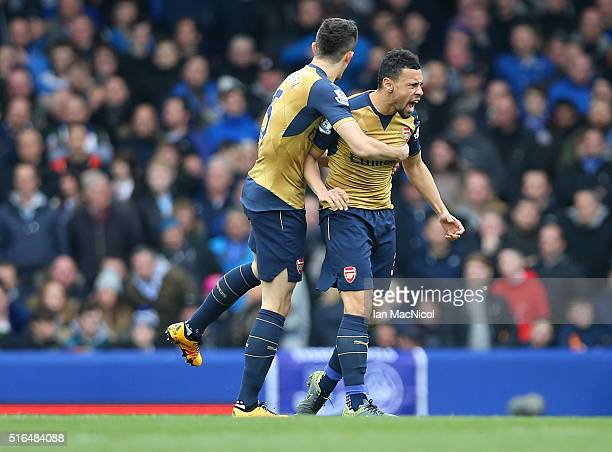 Francis Coquelin and Gabriel of Arsenal celebrate their team's first goal during the Barclays Premier League match between Everton and Arsenal at...