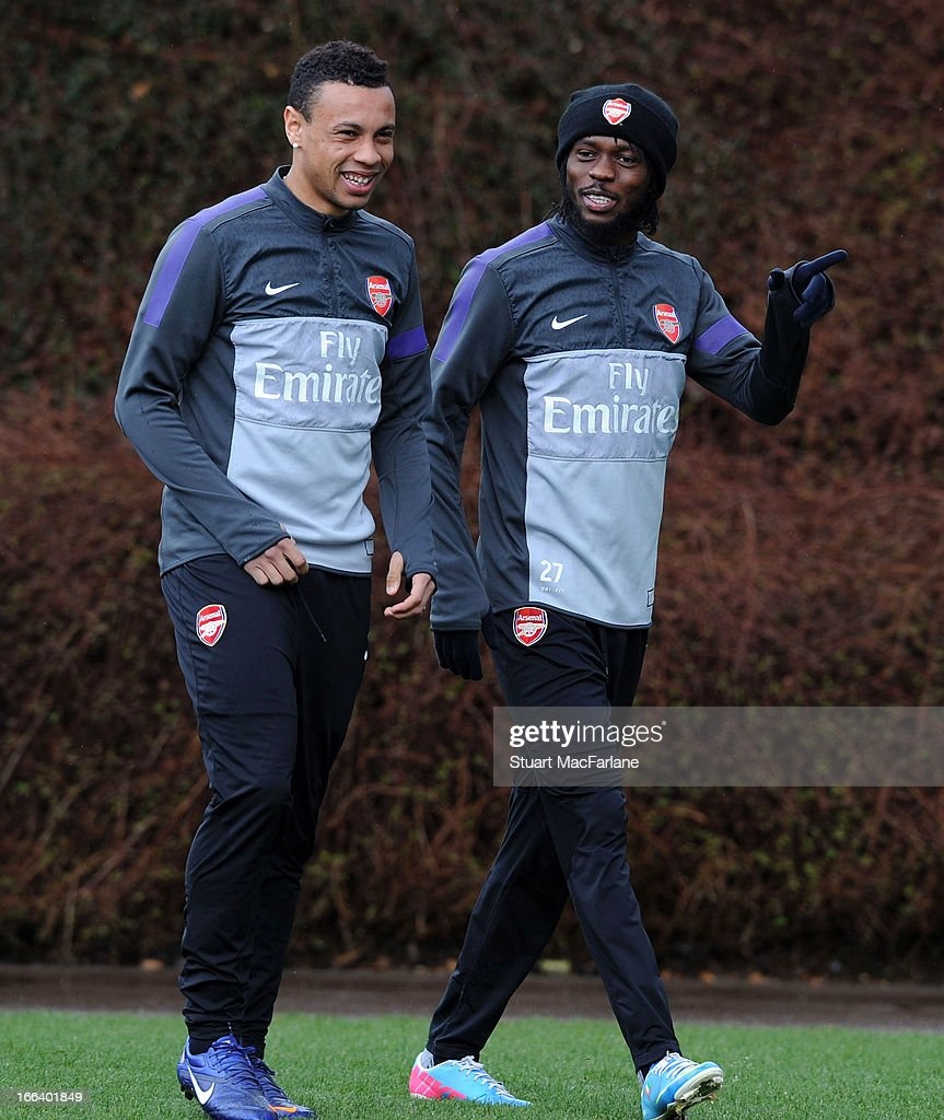 <a gi-track='captionPersonalityLinkClicked' href=/galleries/search?phrase=Francis+Coquelin&family=editorial&specificpeople=8957797 ng-click='$event.stopPropagation()'>Francis Coquelin</a> and <a gi-track='captionPersonalityLinkClicked' href=/galleries/search?phrase=Gervinho&family=editorial&specificpeople=4500752 ng-click='$event.stopPropagation()'>Gervinho</a> of Arsenal before a training session at London Colney on April 12, 2013 in St Albans, England.