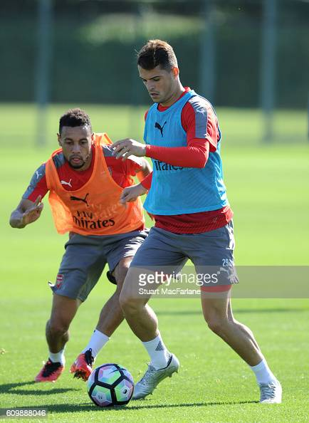 Francis Coquelin and Granit Xhaka of Arsenal during a training session at London Colney on September 23 2016 in St Albans England