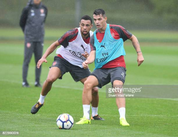 Francis Coquelin and Granit Xhaka of Arsenal during a training session at London Colney on July 26 2017 in St Albans England
