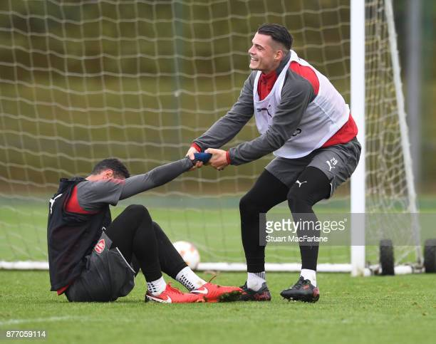Francis Coquelin and Granit Xhaka of Arsenal during a training session at London Colney on November 21 2017 in St Albans England
